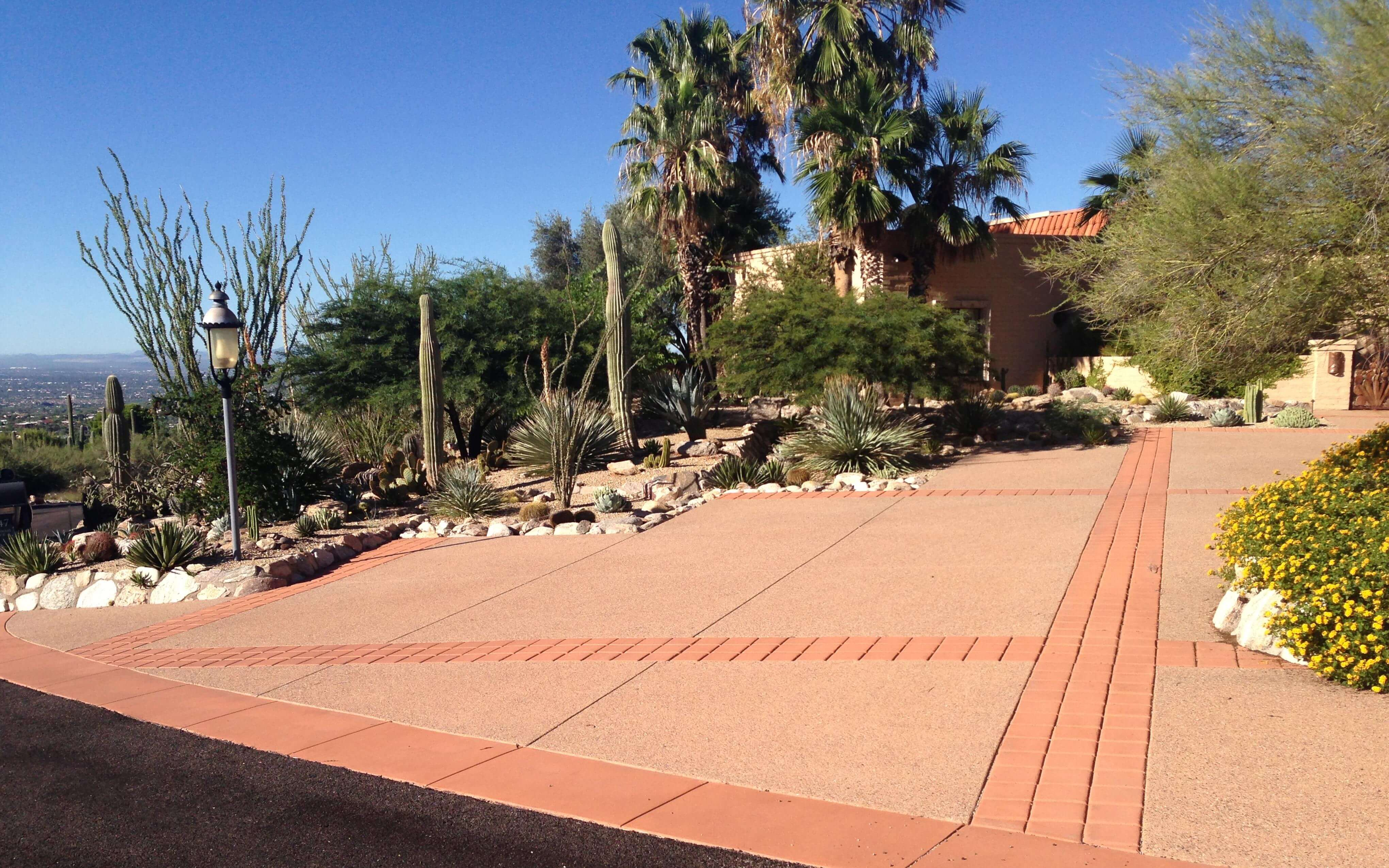 Colored Concrete Driveway with Decorative Concrete Bands
