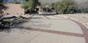 Exposed aggregate concrete driveway with stamped concrete border in Tucson