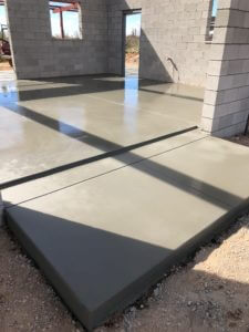 Poured concrete house floors with a large scoring pattern in Pewter color